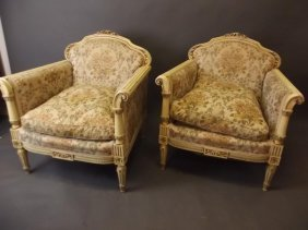 A Pair Of Italian Easy Chairs With Shaped Backs And