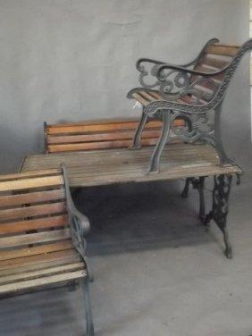 A Suite Of Iron Framed Garden Furniture Comprising An