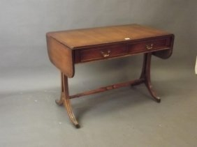 A Regency Style Mahogany Two Drawer Sofa Table With