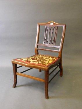 An Edwardian Inlaid Mahogany Nursing Chair With Pierced