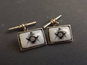 A Pair Of Silver And Enamel Set Cufflinks With Masonic
