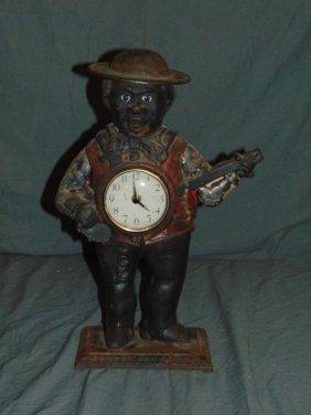 Black Americana Cast Iron Banjo Man Clock