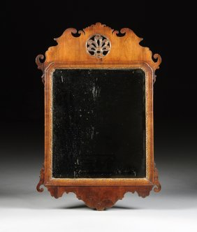 A Queen Anne Carved Wood And Parcel Gilt Mirror, 18th