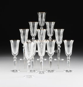 A Set Of Twelve Waterford Cut Crystal And Gold Rim