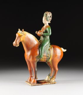 A Chinese Sancai Glazed Pottery Equestrian Maiden