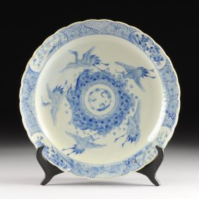 A Large Chinese Blue And White Porcelain Charger, 19th