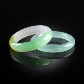 A Chinese Carved Apple Green And Lavender Jadeite