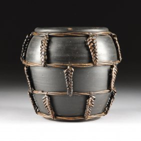 A Vintage Black Painted And Vine Wrapped Earthenware