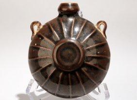A Garnet-glaze Incised-design Porcelain Wine Pot With