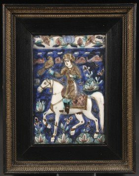 AN 18TH/19TH CENTURY GLAZED PERSIAN TILE REMNANT