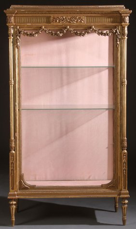 A Louis Xvi Style Carved And Gilt Wood Vitrine
