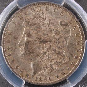 An 1894 Morgan Silver Dollar. Pcgs Au50.