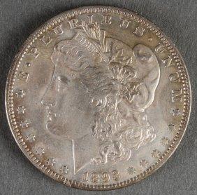 An 1893-o Morgan Silver Dollar. Vf-xf.