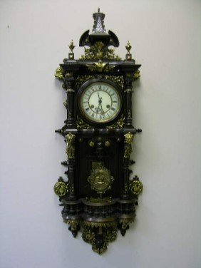 ANTIQUE WALL CLOCK WITH PENDULUM.  OVERALL LENGTH 39