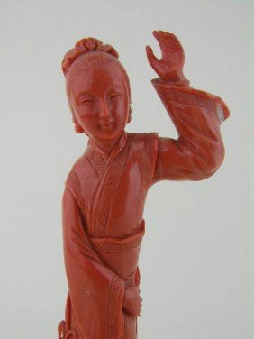Chinese Carved Coral Figure Of A Young Girl.