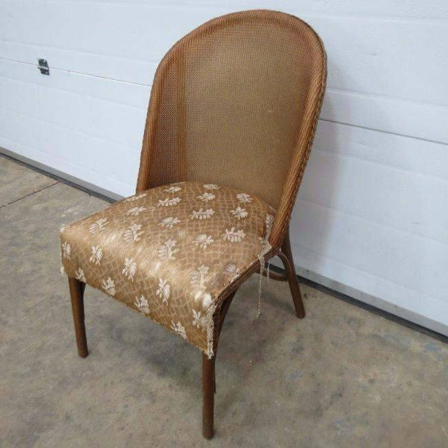 A Lloyd Loom Style Chair By Sirrom Lot 1276
