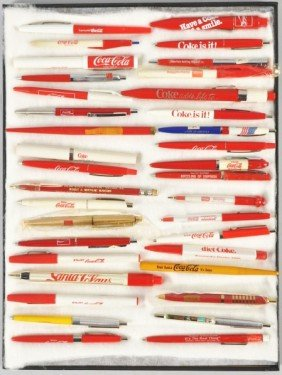 Approximately 35 Coca-Cola Pens & Pencils.