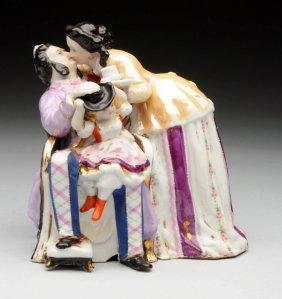 English Porcelain Figure Of A Kissing Couple.
