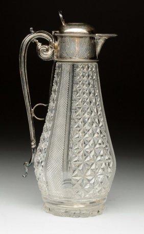 An English Silver-mounted Claret Jug.