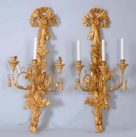 Pair Of Carved Gilt Iron Electric Sconces.