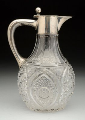 A Continental Silver Mounted Glass Jug.