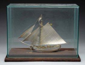 Silver Sailboat In A Glass Case.