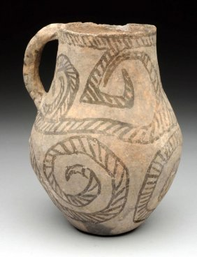 Ancient Pottery Pitcher With A Handle.