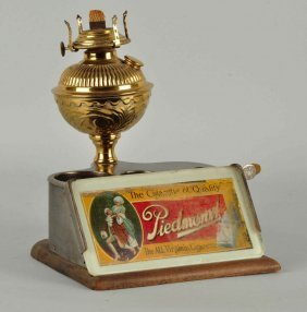 Piedmont Cigarette Lamp & Cigar Cutter.