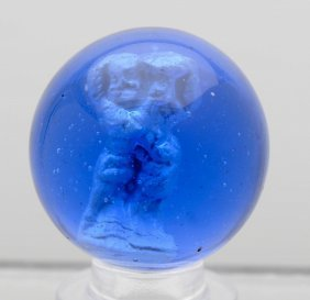 Blue Glass Man Holding Basket Sulphide Marble.