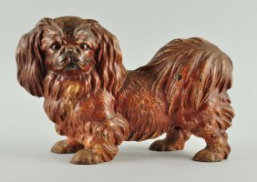 Cast Iron Pekingese Dog Doorstop .