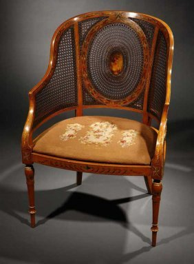 An Edwardian Painted Satinwood Caned Bergere