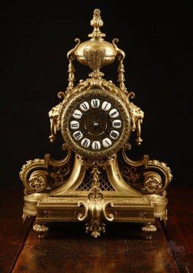 A Louis XVI Style Lacquered Bronze Mantel Clock
