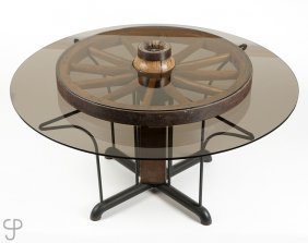 A Smoked Glass And Wagon Wheel Kitchen Table