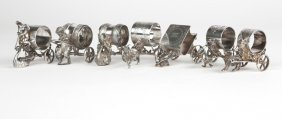 7 Victorian Silver-plated Carriage Napkin Rings