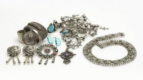 A Collection Of Silver And Metal Jewelry