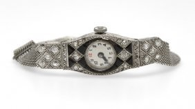 An Art Deco Diamond And Onyx Wristwatch