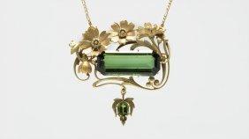 An Art Nouveau Tourmaline Floral Pendant-brooch