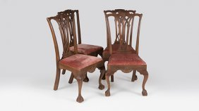 Four Chippendale-style Dining Chairs