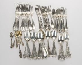 A group of miscellaneous sterling silver flatware