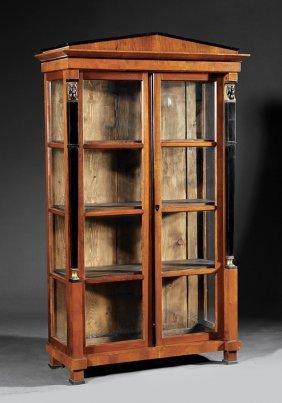 Parcel Gilt And Ebonized Fruitwood Bibliothèques