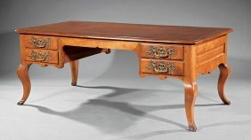 Carved Walnut Gilt Bronze-mounted Bureau Plat