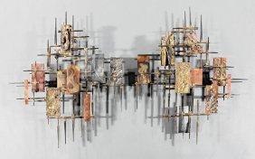 Pair Of Curtis Jere Nail Sculptures