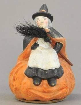 COMPOSITION WITCH ON PUMPKIN CANDY CONTAINER