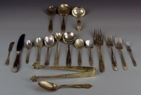 A Group Of Silver Serving Pieces