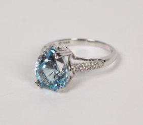 14k White Gold Diamond And Blue Topaz Ring