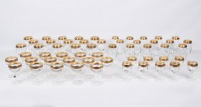 56 Pieces Of Embossed Gold Rimmed Crystal
