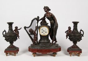French Patinated Metal And Marble Clock Set