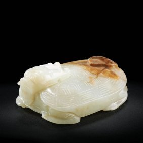 A Chinese White And Russet Jade Mythical Turtle