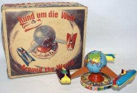 Tin Wind-up Schopper #523 Around The World Rotating