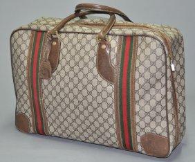 A Gucci Vintage Monogram Canvas Leather Luggage Bag